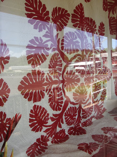 I'll have to go back to get a better photo of this quilt that's in the front window at Kapaia Stitchery.