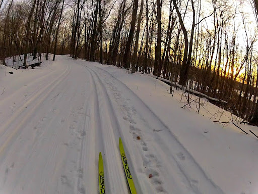 Ski at dusk on Twin Lakes.  Tracks are holding out solid. Icy and thin in spots but no reason to not ski. Some folks are walking down the hills. If you do that, please stay to the far side the trail is in best condition possible for those that choose to ski the hill.