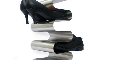 Wonenonline een waar kunstwerk voor in de gang dit schoenenrek for Schilderen voor gang d