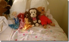 Nadia arranges her stuffed animals at holiday inn, winter 2011 family vacation
