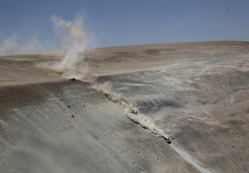 """Mini driver Joan """"Nani"""" Roma, from Spain, and co-driver Michel Perin, of France, compete in the 11th stage of the 2012 Argentina-Chile-Peru Dakar Rally between  Arica, Chile and Arequipa, Peru, Thursday Jan. 12, 2012. (AP Photo/Martin Mejia)"""