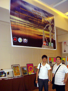Lucky Paltep and Sir Ervin pose in Rights of Disabled Persons Booth.