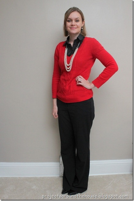 red sweater, black polka dot button down, black pants, pearls