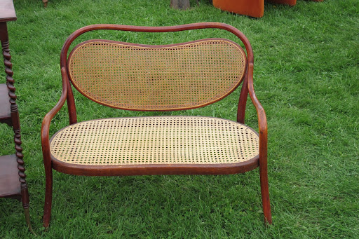 This wicker bench was miniature -- just the right size for a little girl's room.
