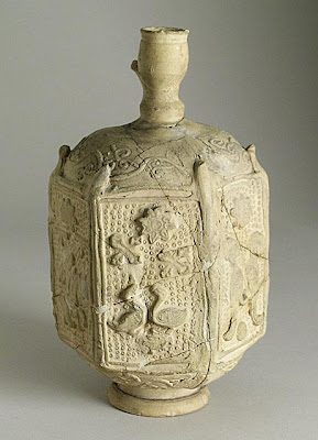 Bottle | Origin: Syria | Period: 12th-13th century | Collection: The Madina Collection of Islamic Art, gift of Camilla Chandler Frost (M.2002.1.94) | Type: Ceramic; Vessel, Earthenware, molded with applied neck, foot and handle (now missing), Height: 7 3/4 in. (19.68 cm)