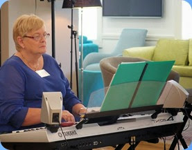 Our host for the day, Barbara McNab, playing her Yamaha Tyros 4. Photo courtesy of Dennis Lyons.