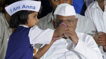 111228022635-anna-hazare-breaks-fast-story-top