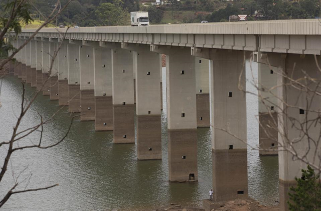 In this 29 January 2015 file photo, a bridge's columns are marked by the previous water line over the Atibainha reservoir, part of the Cantareira System that provides water to the Sao Paulo metropolitan area, in Nazare Paulista, Brazil. In 2015, Brazil's biggest city recorded its rainiest March since 2008, but the worst drought in more than 80 years has left reservoir levels critically low, and water experts fear that strict water rationing may still loom for Sao Paulo as it enters the April-September dry season. Photo: Andre Penner / AP Photo