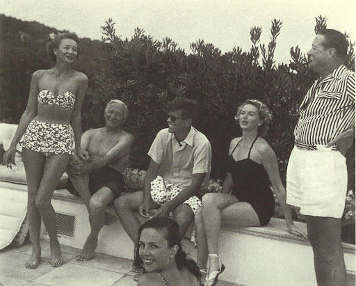 Even presidents take the time to lounge poolside. Cap d'Antibes, France. Villa of Anre Dubonnet, with Elise Hunt, Florette, Jean de Limur, John F. Kennedy, Eugene Thaw. Jacques Henri Lartigue, 1953. (Pools, Kelly Klein, Rizzoli)