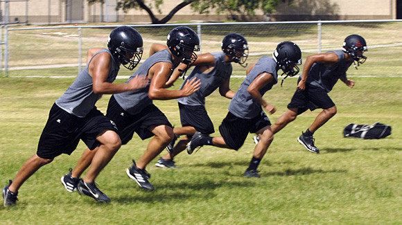 Rivera Raiders run sprints on the first day of football practice on 6 August 2012 in Brownsville, Texas. Temperatures reached into the upper 90s with high humidity. Brad Doherty / The Brownsville Herald