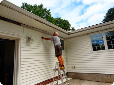 Paul installing siding