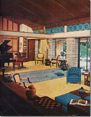 Coming into the living room from the entry area during the day, one feels that he has walked into a richly furnished pavilion, a securely sheltered space under a broad roof resting on substantial stone piers but otherwise open to views of the surrounding landscape. Featured in the February 1960 issue.