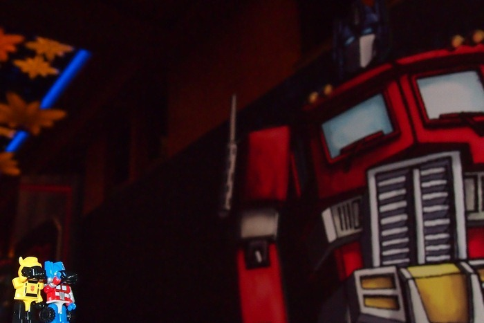 Optimus Prime and Bumblebee taking a picture of G1 Optimus Prime