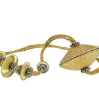 Nowoczesna obejma dekoracyjna do zasłon i tkanin z magnesem. Złota.