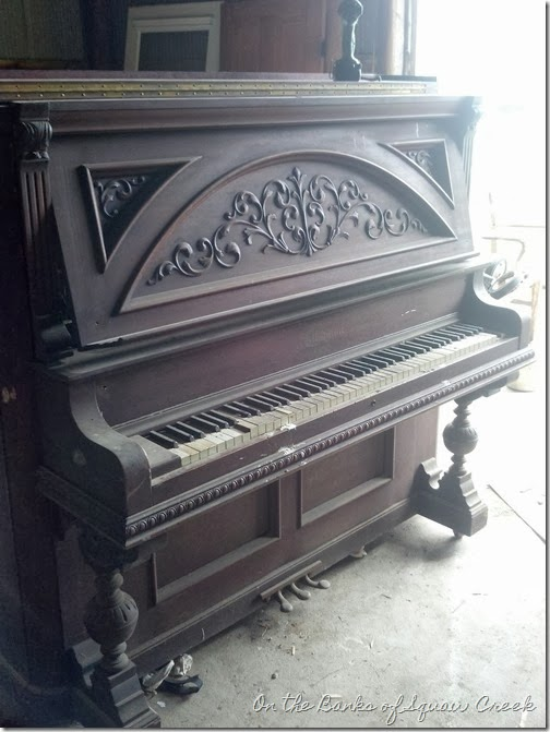 carved front upright piano