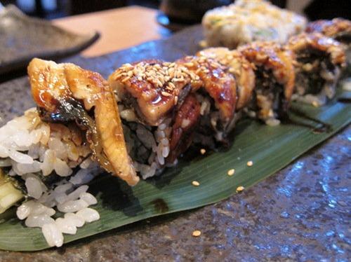 Dragon Makizushi: fresh crab meat, cucumber, avocado, gobo maki with eel on top