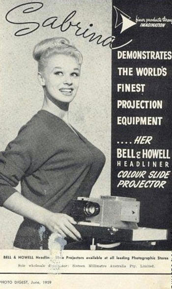 [Bell &amp; Howell] Sabrina demonstrates the worlds finest projection equipment her Bell & Howell headliner Colour Slide Projector