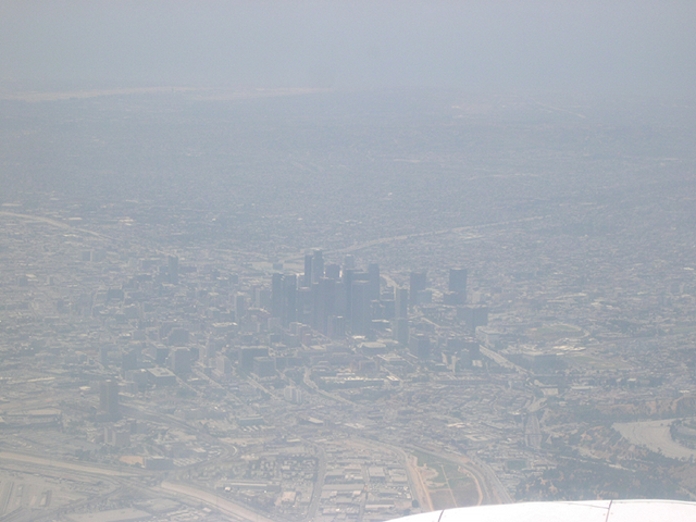 Aerial view of urban smog settling in and around central Los Angeles. Photo: Terry Lathem / NASA