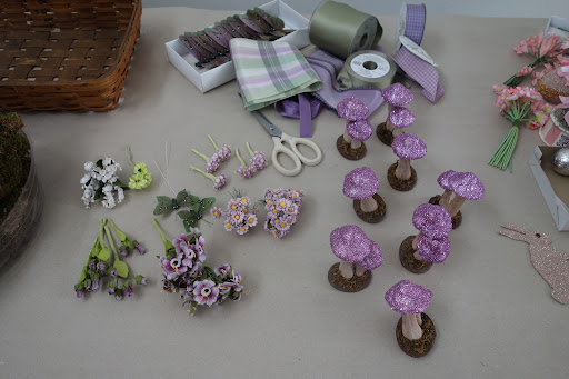 A few yards of vintage lavender ribbon just needed a quick starching, and those mushroom caps went from red to amethyst with a careful coat of glitter from Martha Stewart Crafts.