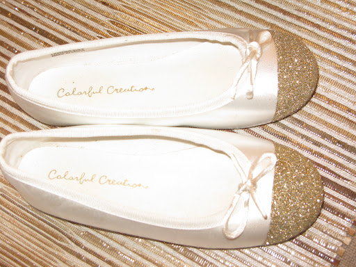 Look how cute these ballet flats are. We simply tape off the tip of the slipper, applied Martha Stewart Craft glitter glue and glittered!