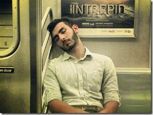 man-sleeping-train-flickr-david_shankbone
