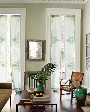 A border of pale-green appliqués dresses up sheer linen curtains without blocking the sunshine.