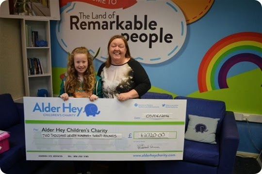 Naomi Barker presents the cheque to Irene Axon from Alder Hey Childrens Charity