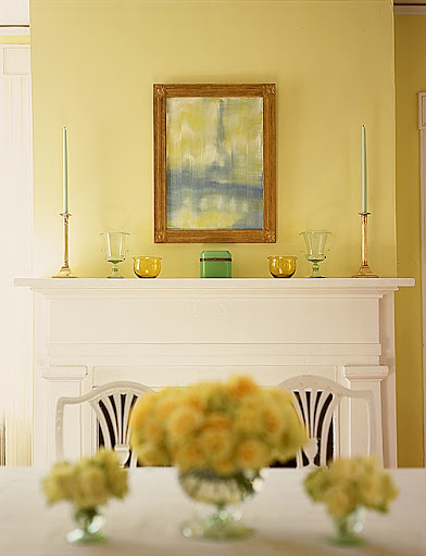 The symmetry of the candlesticks, vases, bowls, and chest gives this mantle a sophisticated and uncluttered look.