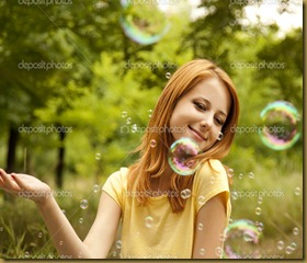 depositphotos_6025292-Redhead-girl-in-the-park-under-soap-bubble-rain.