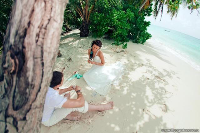 These photos are of a beautiful couple getting married in a tropical paradise