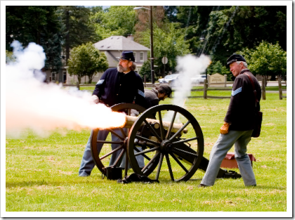 Reenactors firing a howitzer at Fort Vancouver National Park