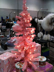 The backstage area at the show was decorated for the holiday season.  That poodle is almost as dressed up as the tree!