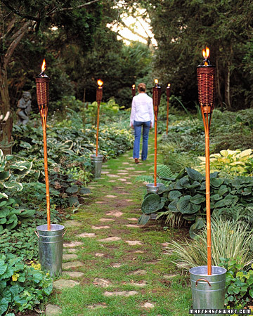 light up your outdoor space with these glowing tiki torches martha