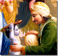 [Krishna bringing slippers to Nanda]