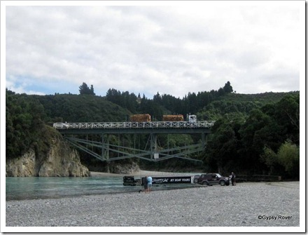 Logging truck passing over the single lane bridge over the Rakaia river.