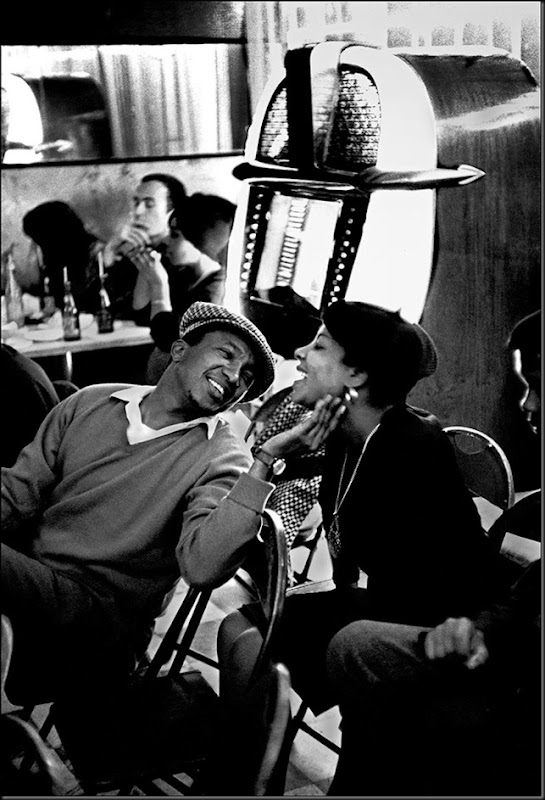 South Africa. Gauteng. Johannesburg. Fordsburg. Affection between two people in a multi-racial cafe. 1961