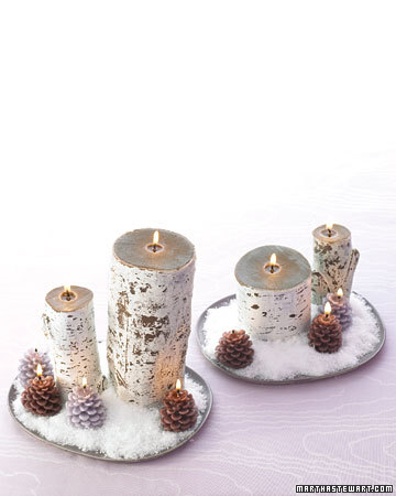 Birch-log and pincone candles sit atop a plate of faux snow -- I can't help but wonder if it will snow before Thanksgiving this year!
