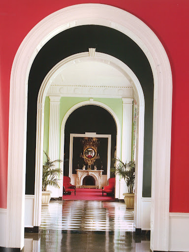 A colorful enflilade looking through to the Victorian wing writing room at the Greenbriar Hotel stays true to Dorothy Draper's original 1940s decoration under the sure hand of protege Carleton Varney. (Regency Redux, Rizzoli)