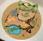 Baby jungle animal shower cake