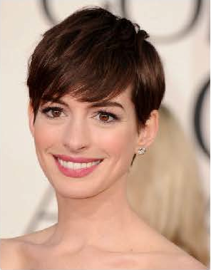 Makeup artist Kate Lee prepped Anne Hathaway's skin with Chanel Hydra Beauty Serum and Base Lumiere Illuminating Makeup Base. A pale peach blush topped the apples of her cheeks, beautifully contrasting her petal pink lips in Chanel Rouge Allure Luminous Lip Colour in Sedusicante. Photo courtesy of Chanel.