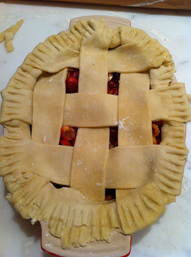 I added the lattice strips, tucked under, pressed, and crimped with a fork.