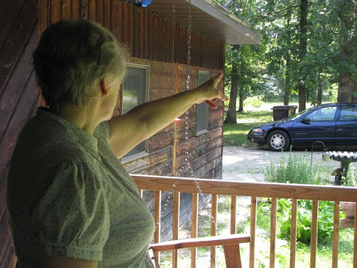 Janice Buchanan points to the path which leads to Purdy's home. (Photo credit: Jennifer Moore)