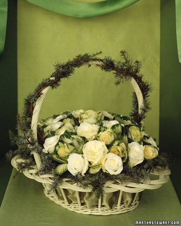 This unusual pairing features two items with similar budlike shapes: creamy-white roses and emerald-green ornamental kale.