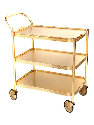 A 70s Gold Trolly to serve desserts on; or set-up a mini cocktail bar on the top. (merchantarchive.com)