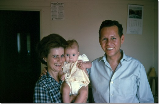 Grandma Willis and Grandpa Debs Webster holding Jana