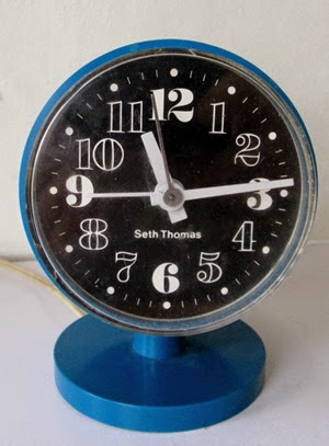 Blue Seth Thomas cylinder alarm clock front