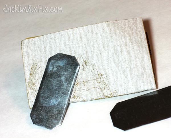 Sanding metal tags