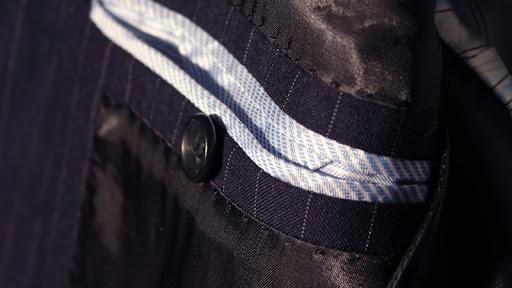 abito gessato taschino giacca