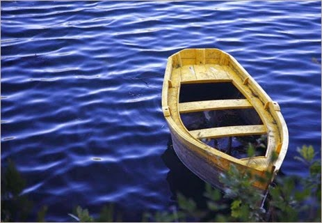 barca-sobre-agua-quique-macc3ada