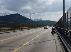 Crossing the Bridge of the Americans with Panama City in the background.
